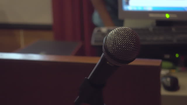 microphone in seminar room - auditorium stock videos & royalty-free footage