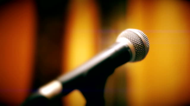 microphone on a stage background. - stage performance space stock videos & royalty-free footage