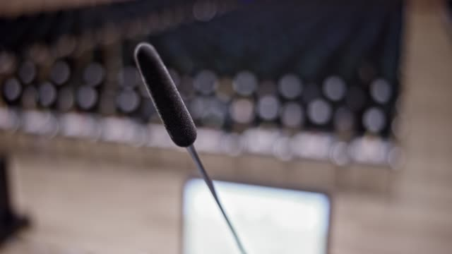 microphone on the podium in the seminar hall - microphone stock videos and b-roll footage