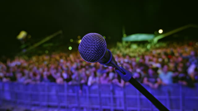 ld microphone on the stage and audience waiting - bühne stock-videos und b-roll-filmmaterial