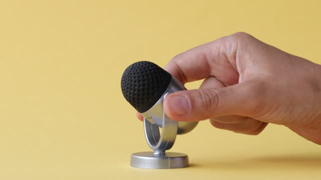 microphone on yellow background - narrating stock videos & royalty-free footage