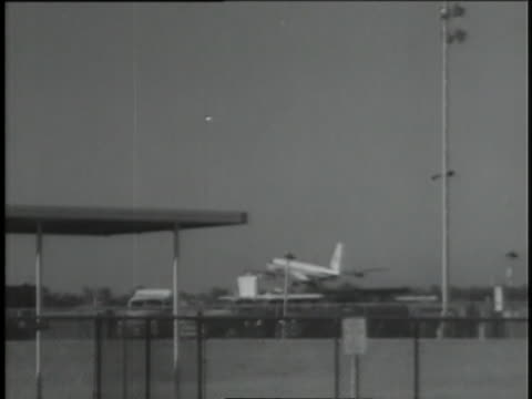 microphones are on the tarmac as servicemen prepare to move president kennedy's coffin from air force one. - john f. kennedy us president stock videos & royalty-free footage