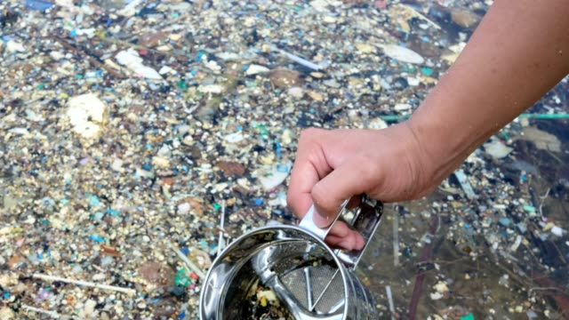 microplastics are very small pieces of plastic that pollute the environment. - land stock videos & royalty-free footage