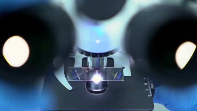Microscope at laboratory. Close-up and slow motion shot