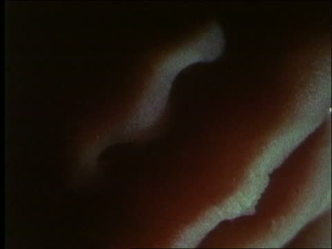 stockvideo's en b-roll-footage met microscopic - extreme close up nose + lips of human fetus (5-6 months) / first days of life - menselijke neus