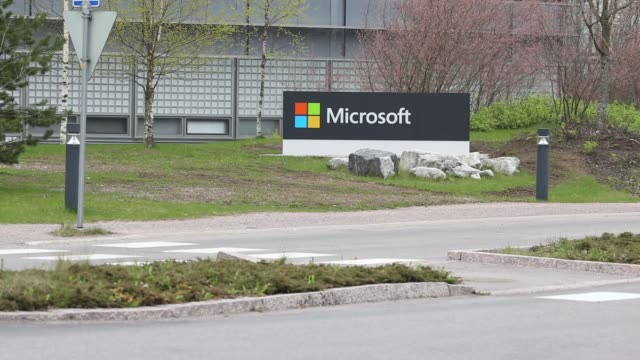 microsoft corp. logo sits on display outside the headquarters of nokia oyj in espoo, finland, on tuesday, may 5, 2015 - headquarters stock videos & royalty-free footage