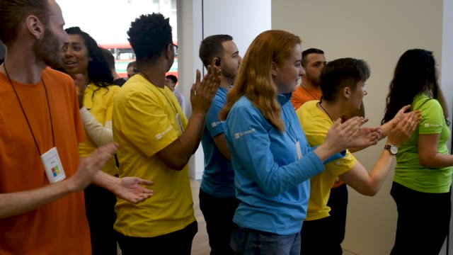 microsoft employees high five shoppers during the microsoft store's opening on july 11 2019 in london england microsoft opened their first flagship... - xbox stock videos & royalty-free footage
