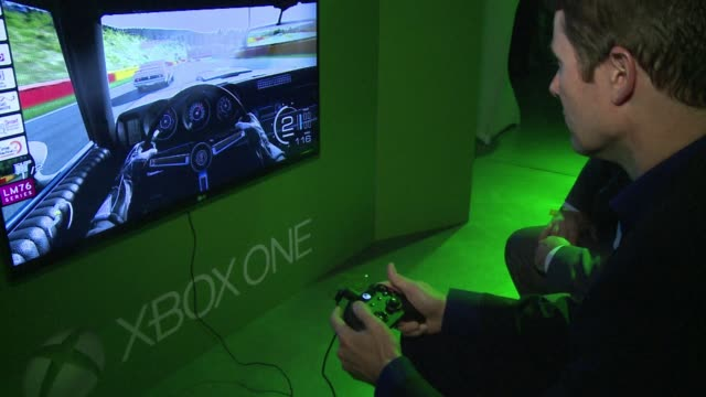 microsoft on friday releases its xbox one game console taking on sonys playstation 4 in a battle for the hearts and minds of internet era home... - xbox stock videos & royalty-free footage