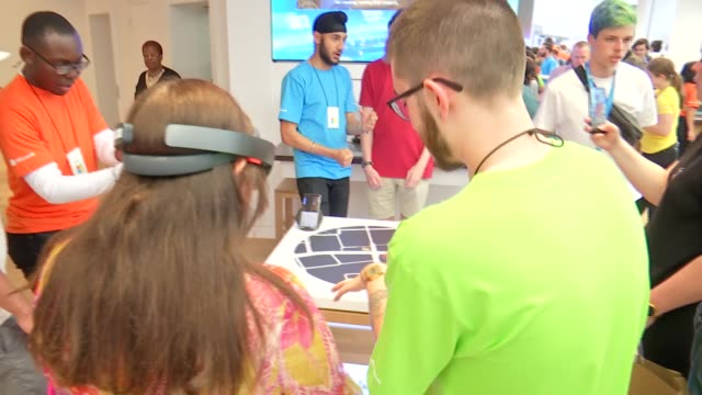microsoft opens flagship store in london england london oxford circus int general views of people inside microsoft store / trying on vr headsets /... - cyberspace stock videos & royalty-free footage