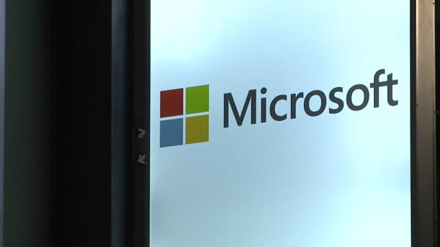 "microsoft sign at the world economic forum in davos switzerland - ""bbc news"" stock-videos und b-roll-filmmaterial"