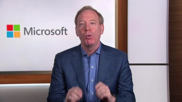 microsoft targets a negative carbon footprint england london / usa int reporter talking via video link with brad smith who is seen on television at... - footprint stock videos & royalty-free footage