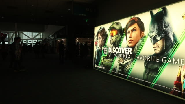 microsoft xbox game pass signage during the e3 electronic entertainment expo in los angeles california us on wednesday jun 12 2019 - poster stock videos & royalty-free footage