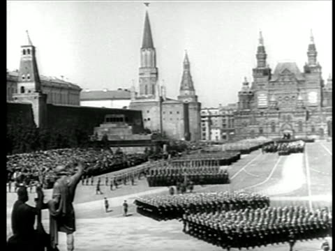 mid 1940s wide shot soviet troops marching thru red square / moscow / newsreel - soviet military stock videos & royalty-free footage