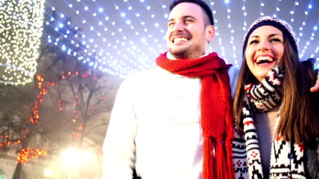 Mid 20's couple enjoying a walk on winter night.