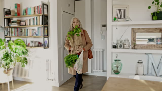 mid 60s woman returning home after food shopping - decor stock videos & royalty-free footage
