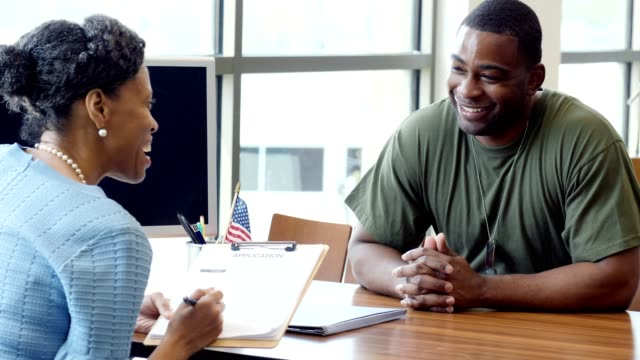 mid adult african american soldier applies for a loan at a local bank - war veteran stock videos & royalty-free footage