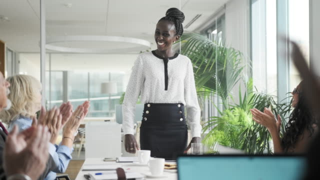 mid adult african businesswoman enjoying positive reception - chief executive officer stock videos & royalty-free footage