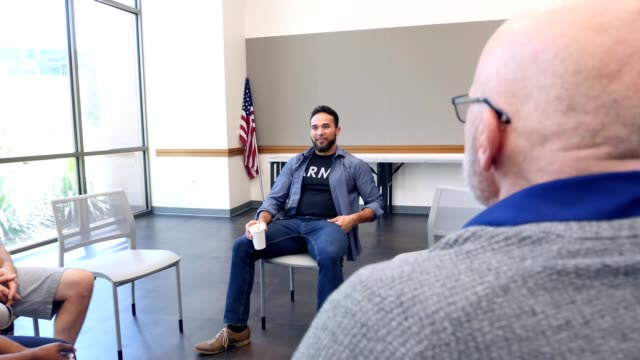 mid adult army veteran leads support group for veterans - community centre stock videos & royalty-free footage