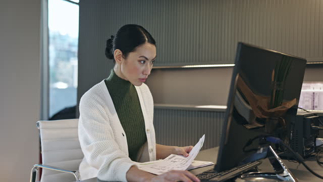 Mid Adult Asian Professional Working at her Desk