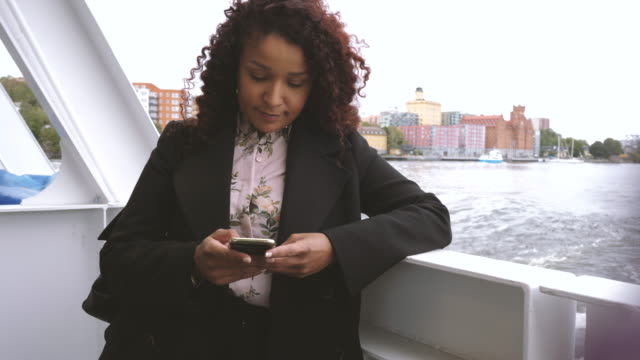 mid adult businesswoman using smart phone on boat deck - ferry deck stock videos & royalty-free footage