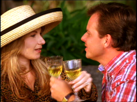 mid adult couple drinking wine at picnic - mid adult couple stock videos & royalty-free footage