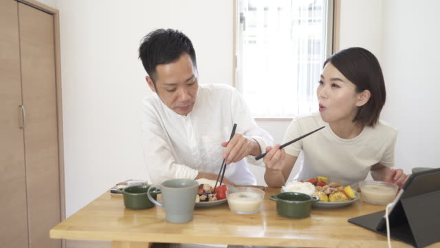 mid adult couple eat lunch at home - mid adult couple stock videos & royalty-free footage