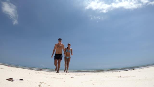 Mid Adult Couple Enjoying Summer Vacations on Beach