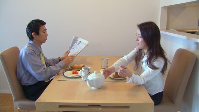 ms, mid adult couple having breakfast - mid adult couple stock videos & royalty-free footage