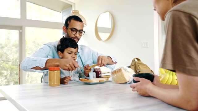 mid adult dad helps his son make a sandwich - sandwich stock videos & royalty-free footage