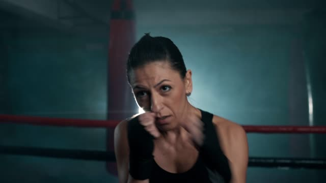 mid adult female boxer shadow boxing - kickboxing stock videos & royalty-free footage