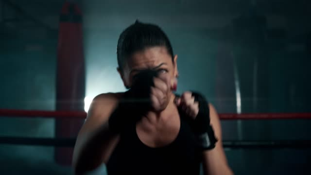 mid adult female boxer shadow boxing - boxing women's stock videos & royalty-free footage