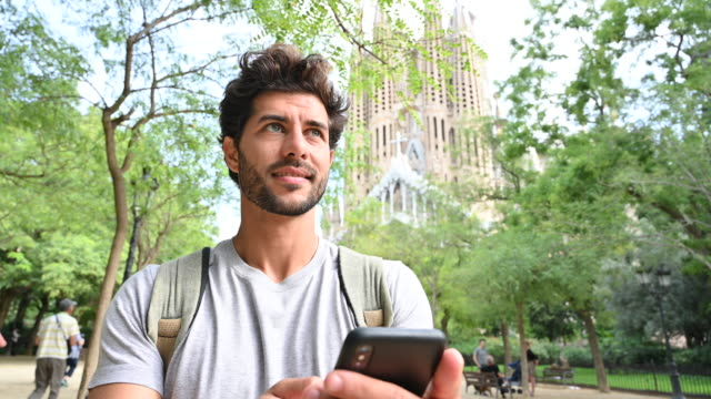 mid adult male tourist checking smart phone for directions - unesco world heritage site stock videos & royalty-free footage