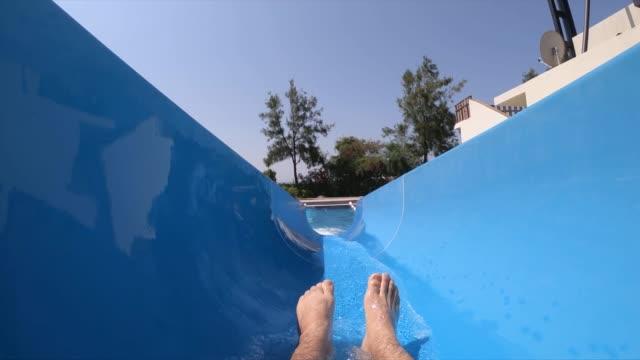 mid adult man having fun on a waterslide - joy stock videos & royalty-free footage
