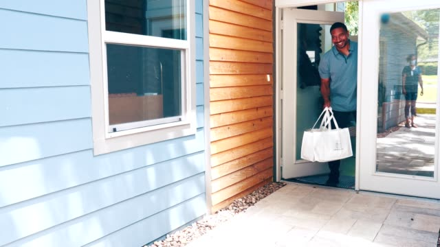 mid adult man receives grocery delivery during covid-19 - leaving stock videos & royalty-free footage