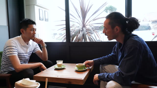 mid adult man relax in cafe with friends - coffee break stock videos & royalty-free footage
