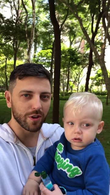stockvideo's en b-roll-footage met medio volwassen mens die met zijn zoon loopt terwijl op een videovraag - genomen met mobiel apparaat