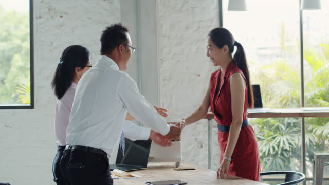 mid adult taiwanese woman bowing and shaking hands after after job interview - bowing stock videos & royalty-free footage