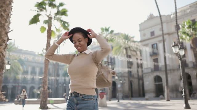 mid adult woman dancing outdoors in the street - adulation stock videos & royalty-free footage