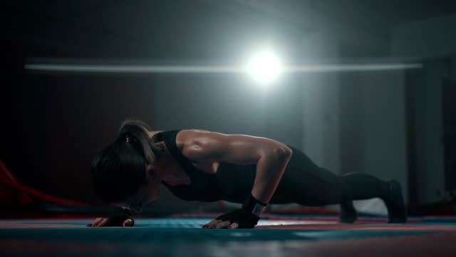 mid adult woman doing push ups - self discipline stock videos and b-roll footage