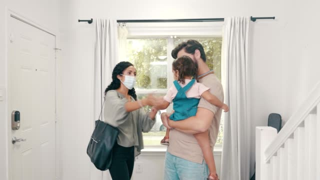 mid adult woman embraces family before going to work during covid-19 - house husband stock videos & royalty-free footage