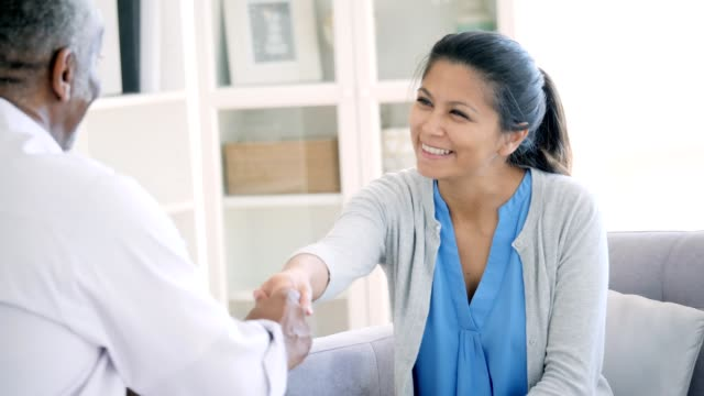 mid adult woman greets mental health professional - advice stock videos and b-roll footage