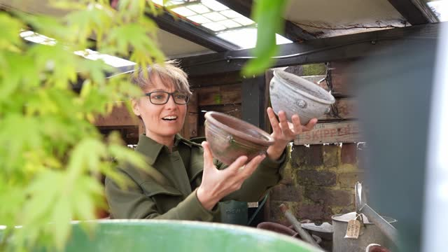mid adult woman looking at pots in garden centre - antique stock videos & royalty-free footage