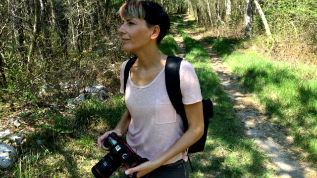 mid adult woman photographer hiking in nature - only mid adult women stock videos and b-roll footage