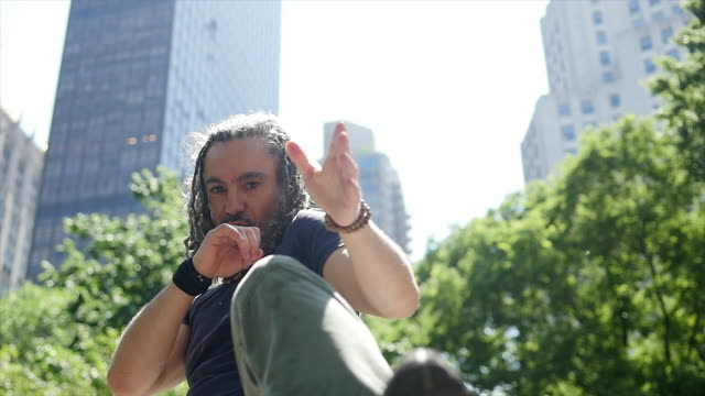 mid age rastafarian man doing martial arts fight boxing training excercise outdoors - rastafarian stock videos & royalty-free footage