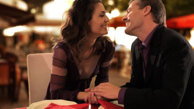 mid aged couple at dinner  - uva video stock e b–roll