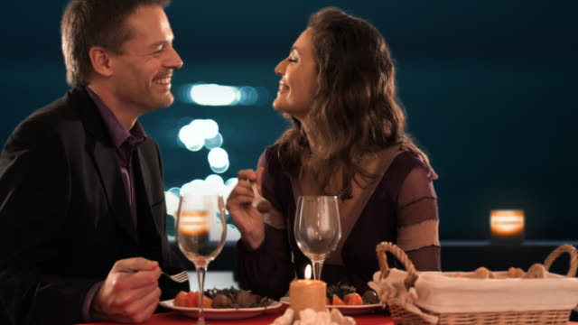 mid aged couple at dinner  - パティオ点の映像素材/bロール