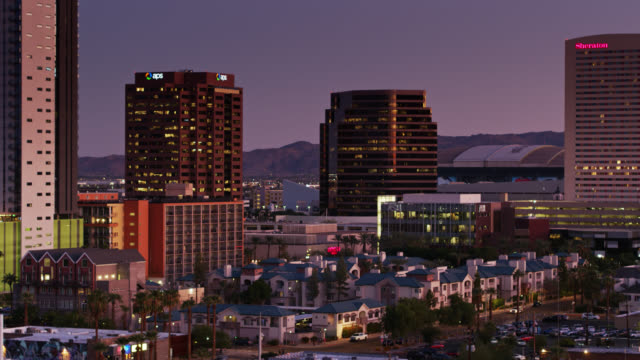 vidéos et rushes de mid and high rise buildings in downtown phoenix, az at twilight - aerial view - arizona