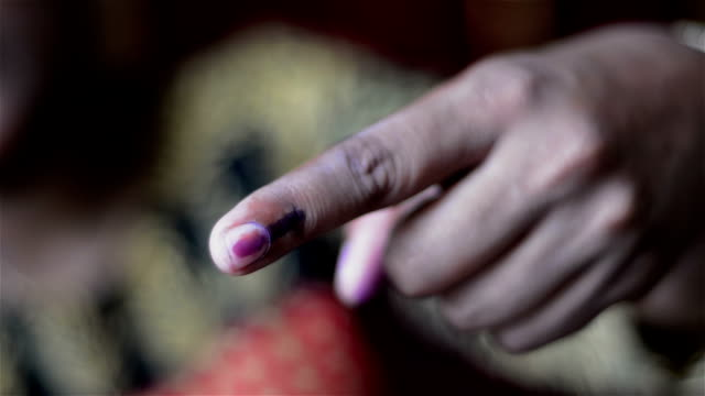 mid close shot of first time indian voter showing voting right - voting stock videos & royalty-free footage