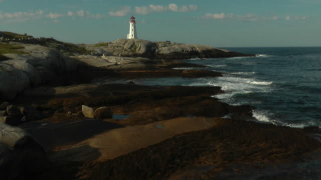 mid day view of world famous peggys cove lighthouse - nova scotia stock videos and b-roll footage