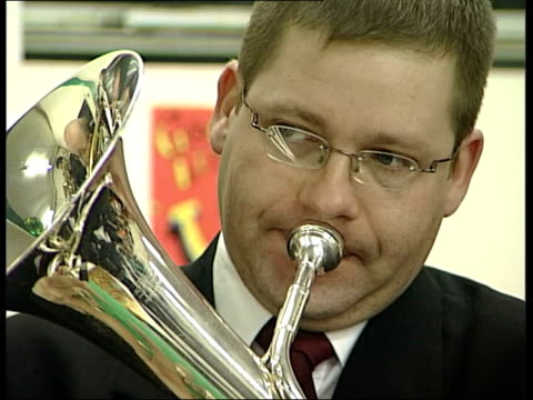 mid glamorgan tower colliery tower colliery brass band performing 'once in royal david's city' sot cs man playing brass instrument cms miner with... - brass band stock videos & royalty-free footage